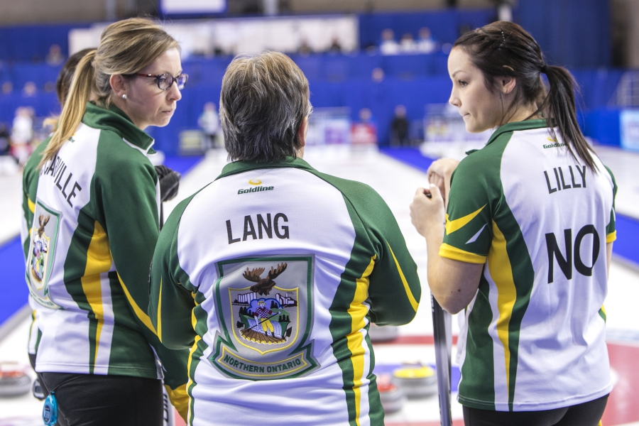 Northern Ontario skip Krista McCarville third Kendra Lilly and coach Lorraine Lang in draw eleven action at the 2016 Scotties Tournament of Hearts, the Canadian Womens Curling Championships, Grande Praire, Alberta